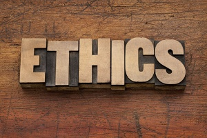 Ethics on Wooden Background